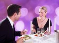 Couple enjoying candlelight dinner at restaurant happy young table Stock Image