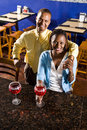 Couple enjoying drinks in a restaurant Stock Photos