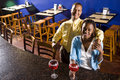 Couple enjoying drinks at a restaurant Stock Images