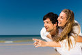 Couple enjoying freedom on the beach Royalty Free Stock Photos