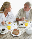 Couple enjoying healthy breakfast at the table Royalty Free Stock Photos