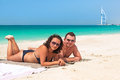 Couple enjoying holidays on the beach of dubai uae Royalty Free Stock Image