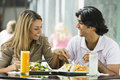 Couple enjoying lunch at cafe Royalty Free Stock Photo