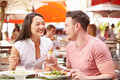 Couple Enjoying Lunch In Outdoor Restaurant Royalty Free Stock Photo