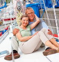 Couple enjoying mature sailboat 库存图片