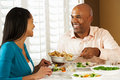 Couple Enjoying Meal At Home Stock Images