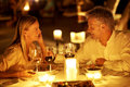 Couple enjoying a romantic candlelight dinner Royalty Free Stock Photos