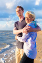 Couple enjoying romantic sunset on beach at german north sea Stock Photography