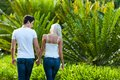 Couple enjoying romantic walk in park. Royalty Free Stock Image