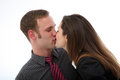 Couple enjoying spontaneous kiss Stock Image