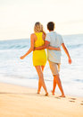Couple enjoying sunset on the beach romantic beautiful tropical Stock Image