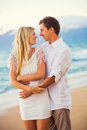 Couple enjoying sunset on the beach romantic beautiful tropical Royalty Free Stock Image