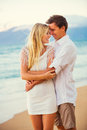 Couple enjoying sunset on the beach romantic beautiful tropical Royalty Free Stock Images