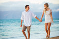 Couple enjoying sunset on the beach romantic beautiful tropical Stock Photo
