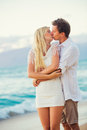 Couple enjoying sunset on the beach romantic beautiful tropical Stock Images