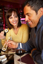 Couple Enjoying Sushi In Restaurant Stock Image