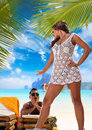 Couple enjoying their summer holidays portrait of happy beautiful on a tropical beach Stock Image