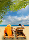 Couple enjoying their summer holidays portrait of happy beautiful on a tropical beach Royalty Free Stock Photos