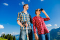 Couple enjoying view hiking in the alpine mountains Royalty Free Stock Photo