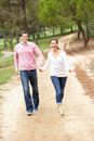 Couple enjoying walk in park Stock Images
