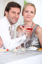 Couple enjoying wine with dinner Stock Photos