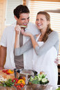 Couple enjoys preparing dinner together Royalty Free Stock Photo