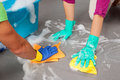 Couple equality in home wash the floor together Royalty Free Stock Photography