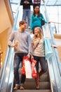 Couple On Escalator In Shoppin...