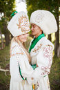 Couple in ethnic clothes outdoors. Royalty Free Stock Photo
