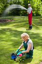 Couple during everyday duties in garden married Stock Photo