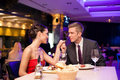 Couple exchanged tenderness at restaurant young affectionate holding hands together Royalty Free Stock Images