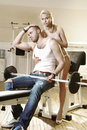 Couple in exercise room Stock Image