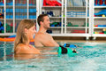 Couple exercising Aquarobics Royalty Free Stock Image