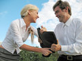 Couple fighting for briefcase Royalty Free Stock Image