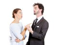 Couple fighting closeup portrait of man woman pointing fingers at each other blaming for problem mistakes isolated on white Stock Photo