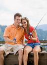 Couple fishing on pier Royalty Free Stock Image