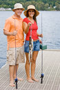 Couple fishing on pier Royalty Free Stock Photography
