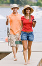 Couple fishing on pier Stock Images