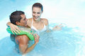 Couple with floating ring in pool Royalty Free Stock Images