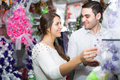 Couple in a flower shop Royalty Free Stock Photo