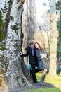 Couple in the forest by tree Royalty Free Stock Image
