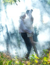 Couple in a forest young beautifu Royalty Free Stock Photography