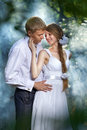 Couple in a forest young beautifu with smoke Royalty Free Stock Photography
