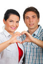 Couple forming heart with their hands Royalty Free Stock Image