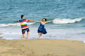 Couple frolic the on seabeach in sanya hainan china Stock Image