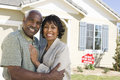 Couple In Front Of Home For Sale Royalty Free Stock Photo
