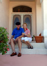 Couple front porch senior Arkivfoton