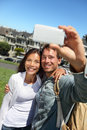 Couple fun taking self portrait photo with cell phone camera multiracial happy tourist couple on travel vacation in san francisco Stock Photos