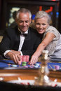 Couple gambling at roulette table Stock Image