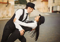 The couple of gangsters is in a street are dancing Royalty Free Stock Photography